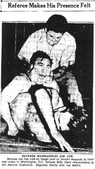 Wresting ref grabbing guy's mouth