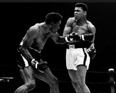 Powell mixing it up with Cassius Clay (Muhammad Ali).