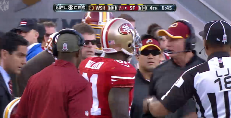The 49ers' Anquan Boldin and Redskins defensive coordinator Jim Haslett debate the proper way to baste a turkey.