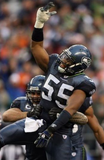 Darryl Tapp celebrates a sack with the Seahawks.