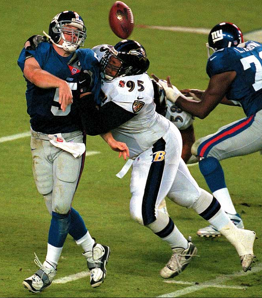 Sam Adams puts a body on the Giants' Kerry Collins in Super Bowl 35.