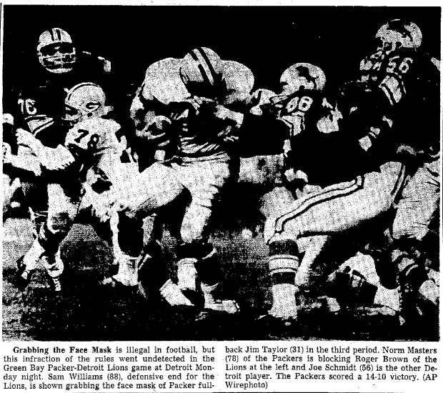 9-30-64 Appleton Post-Crescent photo of Lion grabbing Packer's facemask