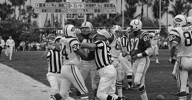 The Jets' Johnny Sample (24) and the Colts' Tom Matte (41) go facemask-to-facemask in Super Bowl III.