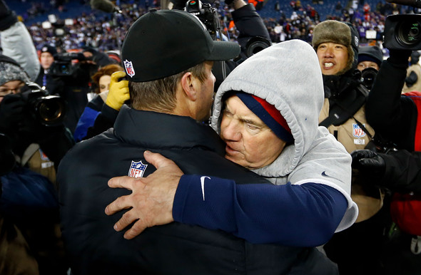 John Harbaugh and Bill Belichick: a warm embrace after a cold AFC title game.