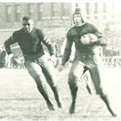 Duke Slater, helmetless, looks for somebody to block during his days at Iowa.