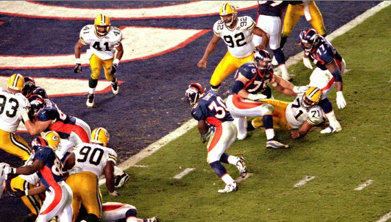 The Packers defensive line opens wide in Super Bowl 32 to let Denver's Terrell Davis score.