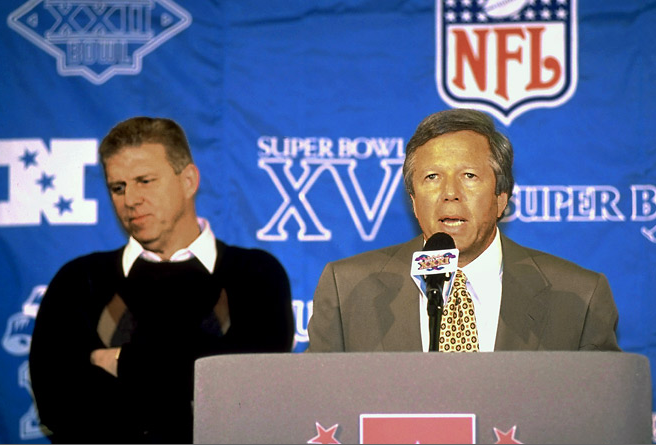 Bill Parcells and Patriots owner Bob Kraft pretending to get along at Super Bowl 31.
