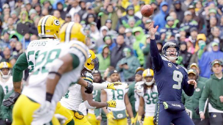 Seahawks punter Jon Ryan heaves a TD pass in the NFC title game vs. the Packers.