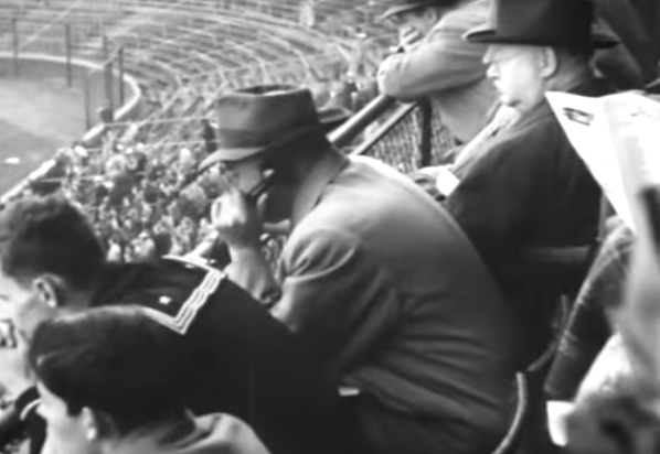 Assistant coach Luke Johnsos supplying the Bears sideline with intelligence in 1944.