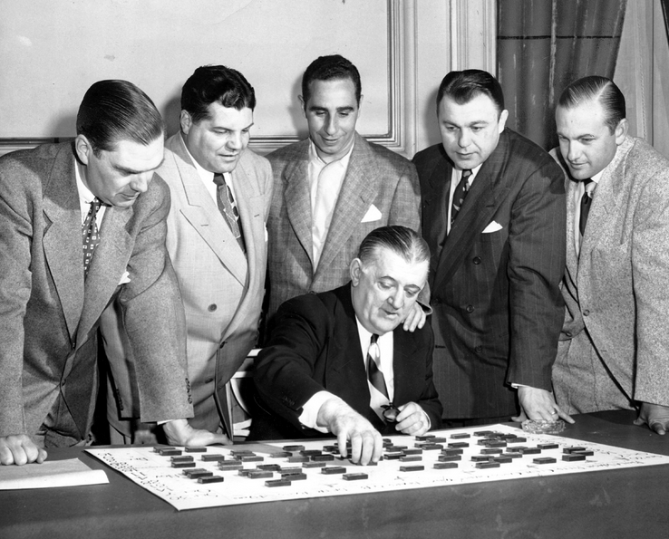 Nobody hated the PAT more than NFL commissioner Bert Bell (shown here working in the schedule -- with dominoes).
