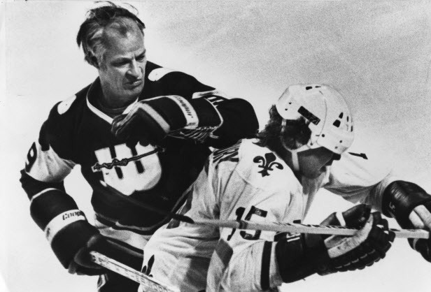 Howe without helmet, opponent with one