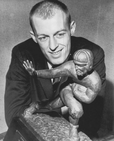 """Terry Baker: a better arm """"for carrying around a trophy [than] throwing a football."""""""