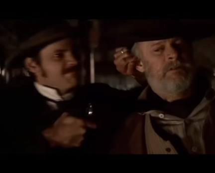 "Sheriff Bullock escorts George Hearst to the hoosegow in ""Deadwood."""