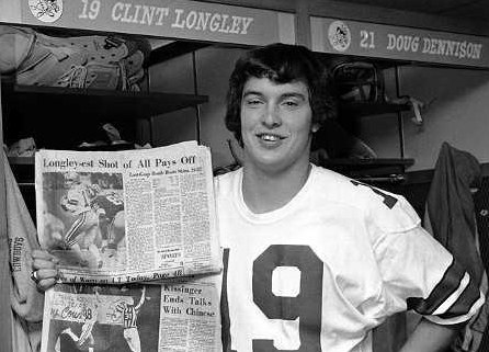 Longley brandishes his clippings after the '74 Redskins game.